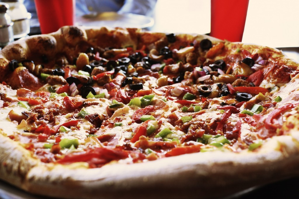 Tasty, authentic NYC pizza is waiting for you at Prince Street.